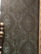 The lobby wall paper is skulls